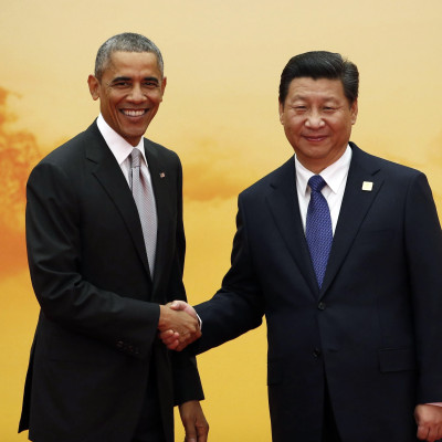 U.S. President Obama shakes hands with China's President Xi in Beijing